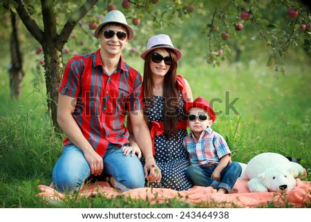 Happy young family wearing sun glasses and hats  is having fun i - stock photo