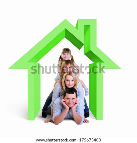 Happy young family with children in house - stock photo