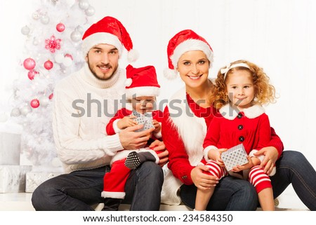 Happy young family with two children on Christmas