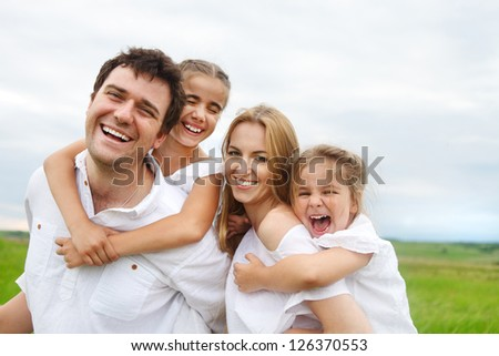 Happy young family with two children outdoors