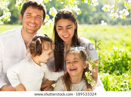 Happy young family with two children outdoors. Spring day