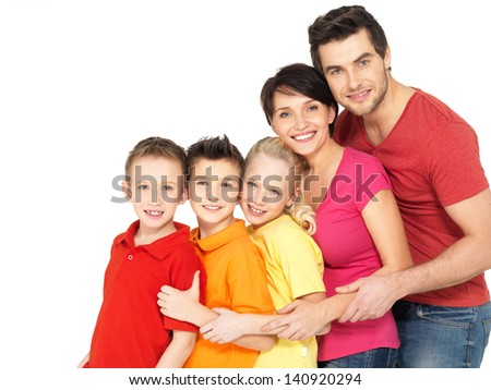 Happy young family with two children standing together in line - isolated on white background - stock photo