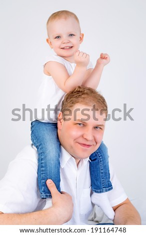 happy young father and his daughter in bed at home  - stock photo
