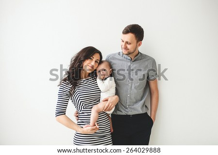 Happy young father, mother and cute baby boy over white background - stock photo