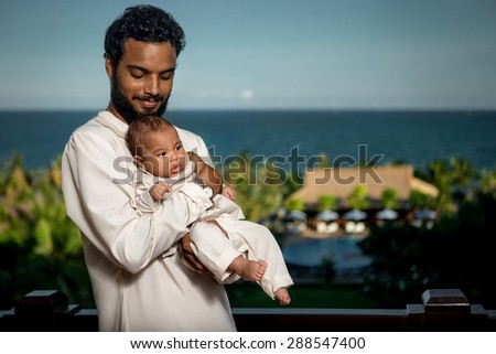 Happy Young Father with Newborn Baby - stock photo