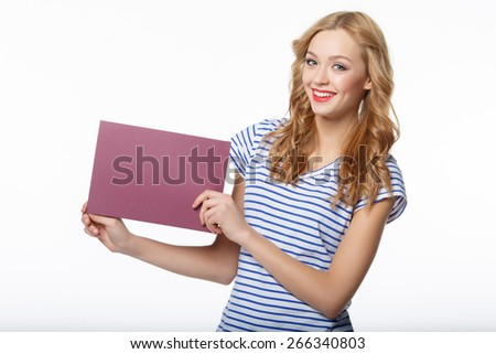 Happy young female holding a blank billboard on white background