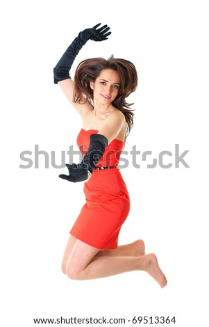 happy young female in red strapless dress and black gloves jumps up, isolated on white - stock photo