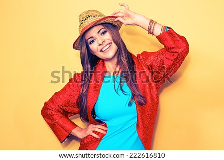 happy young female model. smiling woman fashion style portrait. blue dress. red cape. - stock photo