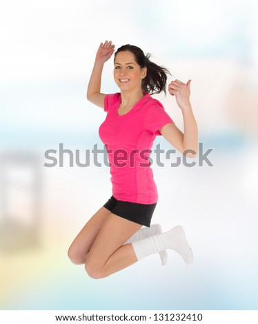 Happy young fitness woman jumping - stock photo