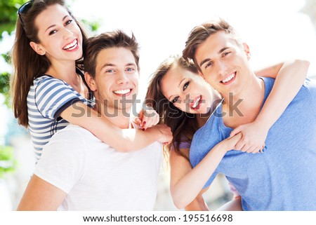 Happy young friends - stock photo