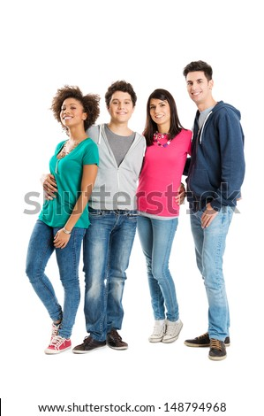 Happy Young Friends Standing In A Row Isolated on White Background