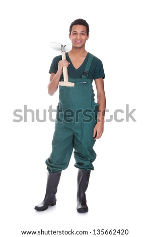 Happy young gardener in dungarees. Isolated on white - stock photo