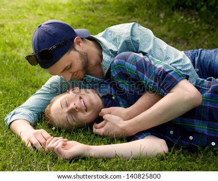 Happy Young Gay Couple Outside - stock photo