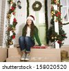 happy young girl at home decorated on Christmas - stock photo