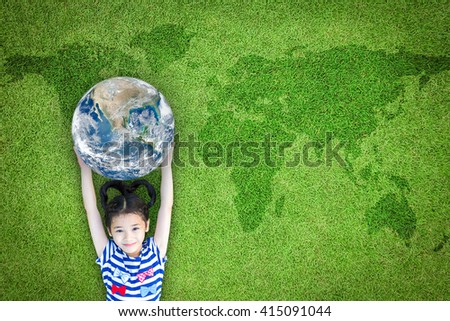 Happy young girl child kid raising blue marble planet earth grass ground lawn nature background: World sustainable environment CSR ESG eco bio friendly concept: Element of the image furnished by NASA - stock photo