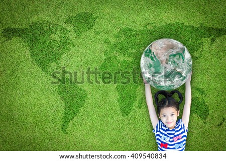 Happy young girl child kid raising go green planet earth on grass ground lawn nature background: World sustainable environment CSR ESG eco bio friendly concept: Element of the image furnished by NASA  - stock photo