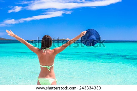Happy young girl enjoy tropical beach vacation - stock photo