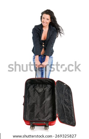 Happy young girl going on vacations with blank suitcase