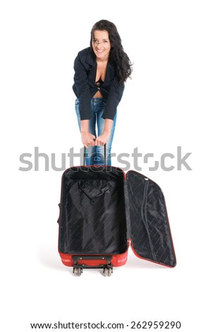 Happy young girl going on vacations with suitcase