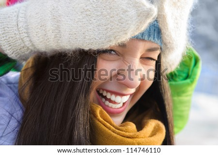 Happy young girl having fun in winter park - stock photo