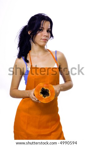 Happy young girl holding a piece of papaya fruit - isolated