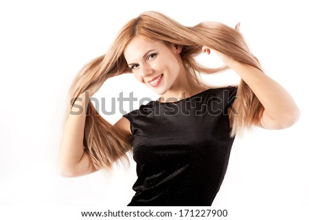 Happy young girl in a black dress - stock photo