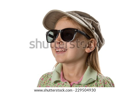 Happy - Young girl in green hat and sunglasses, smiling at copy space or other object / scene.  Isolated on white. - stock photo