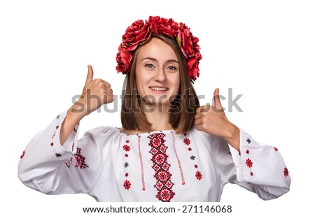 Happy young girl in the ukrainian national suit isolated on white - stock photo