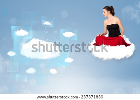 Happy young girl looking at modern cloud network - stock photo