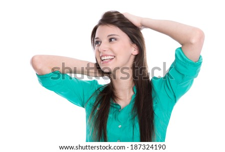 Happy young girl looking at the side in green blouse isolated on white. - stock photo