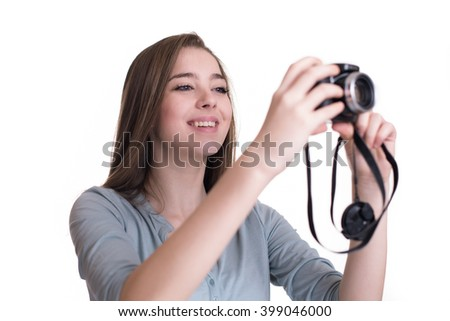 Happy young girl making photo with camera