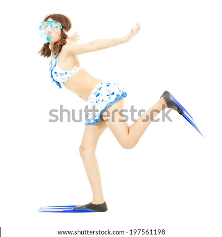 happy young girl runs with scuba diving equipment - stock photo