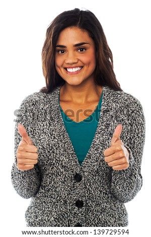 Happy young girl showing double thumbs up to the camera - stock photo