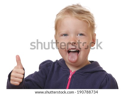 Happy young girl shows thumbs up on white background - stock photo