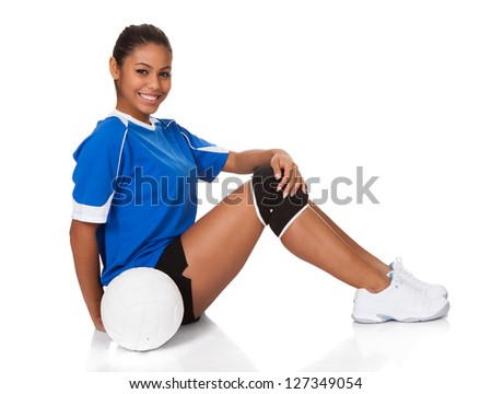 Happy Young Girl Sitting With Volleyball. Isolated On White - stock photo