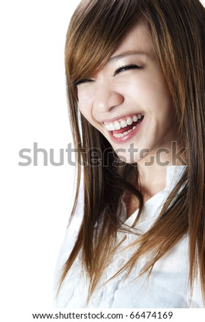 Happy young girl smiles happily - stock photo