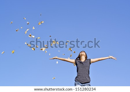happy young girl who leaves the air - stock photo