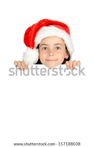 Happy young girl with Santa's hat posing with big board