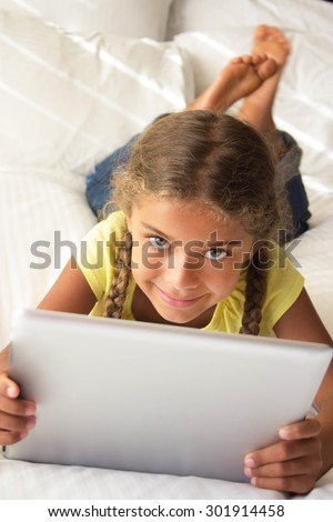 Happy Young Girl with Tablet - stock photo