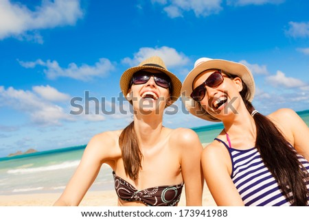 Happy young girls having fun on the beach. - stock photo