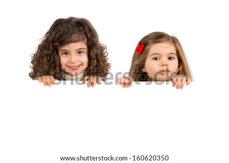 Happy young girls posing with a white board