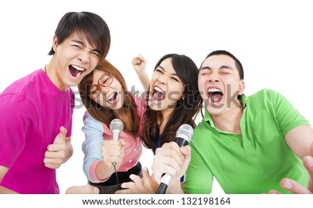 happy young group having fun singing with karaoke - stock photo
