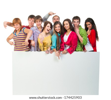 Happy young group of people standing together and holding a blank sign for your text. isolated on white background
