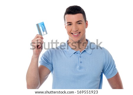 Happy young guy displaying his cash card