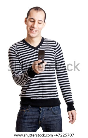 Happy young guy sending a text message,  isolated on white background