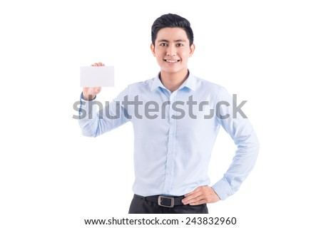 Happy young handsome asian man holding and showing blank card ready for your text - stock photo