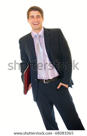 Happy young handsome businessman holding laptop computer smiling over white background - stock photo