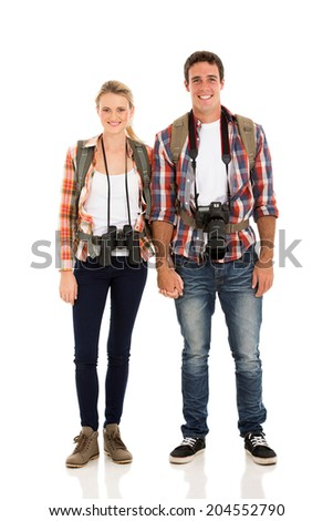happy young hiker couple holding hands - stock photo