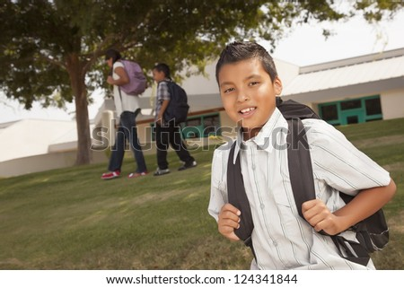 Happy Young Hispanic Boy with Backpack Ready for School. - stock photo
