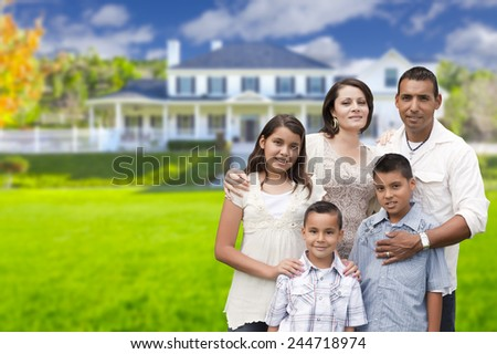 Happy Young Hispanic Family in Front of Their New Home. - stock photo